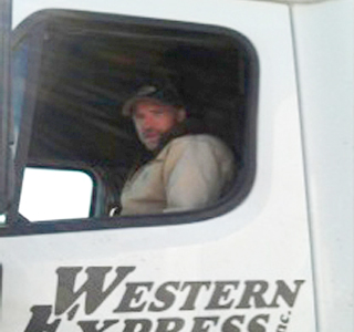Man driving a semi truck