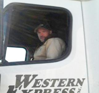 Man driving a semi truck